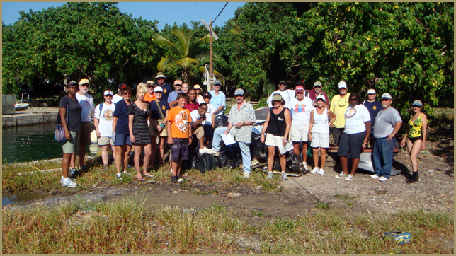 Rotary Club volunteers clean up the beach at Careening Cove